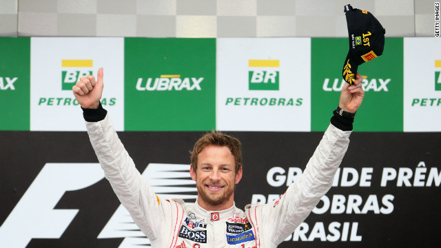 "Button salutes the crowd at Interlagos following his victory. He said: ""First of all I want to congratulate the whole team. This is the perfect way to end the season. We have had ups and downs and to end on a high bodes well for 2013."""