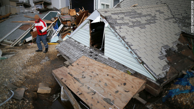 David McCue stands near the roof of his beach house, which was completely demolished by Superstorm Sandy, in Ortley Beach, New Jersey, on Sunday, November 25. &lt;strong&gt;&lt;a href='http://www.cnn.com/2012/10/30/us/gallery/sandy-damage/index.html' target='_blank'&gt;See photos of the immediate aftermath of Sandy.&lt;/a&gt;&lt;/strong&gt;