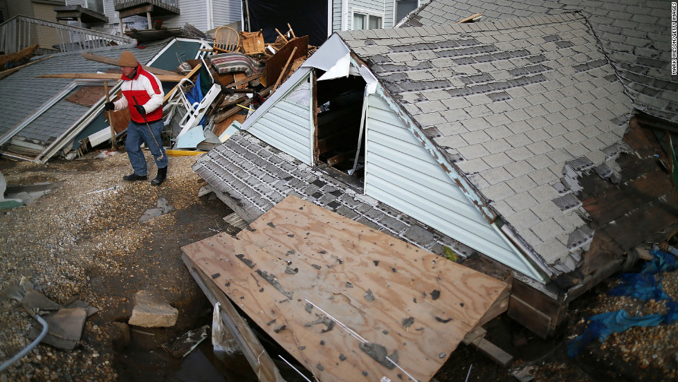 David McCue stands near the roof of his beach house, which was completely demolished by Superstorm Sandy, in Ortley Beach, New Jersey, on Sunday, November 25. <strong><a href='http://www.cnn.com/2012/10/30/us/gallery/sandy-damage/index.html' target='_blank'>See photos of the immediate aftermath of Sandy.</a></strong>