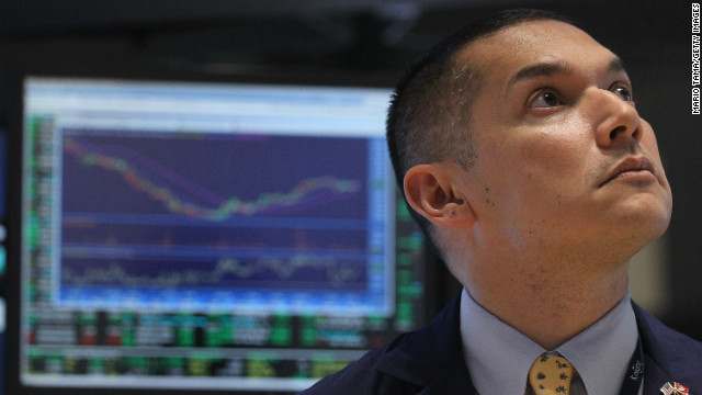 A trader works at the New York Stock Exchange, which has seen rising prices due to optimism about the prospects of a 
