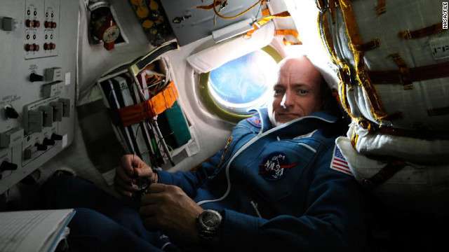 Capt. Scott Kelly will set the record for the longest single space mission for an American astronaut and spend one year on the International Space Station in 2015, NASA announced in November 2012. Kelly, Expedition 25 flight engineer, is pictured inside the Soyuz TMA-01M spacecraft on docking day with the space station.