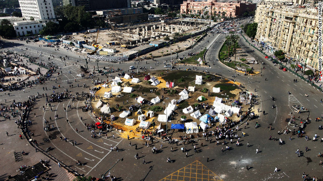 Protesters gather at sit-in tents in Tahrir Square on Sunday.