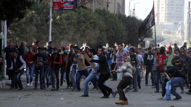 Egyptian protesters hurl stones at police at Tahrir Square on Sunday.
