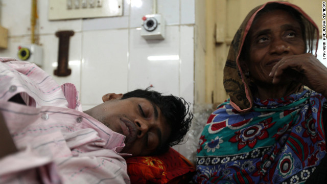 Masud Rana, one of the survivors, receives treatment at Dhaka Medical Hospital on November 26. The factory was owned by Tazreen Fashions, which manufactured clothing for C&amp;amp;A, Carrefour and Wal-Mart, reports said. Wages at the factory are about $43 a week for a garment worker.