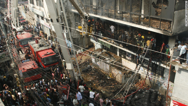 Bangladeshi firefighters stand in the burned-out building on November 26.