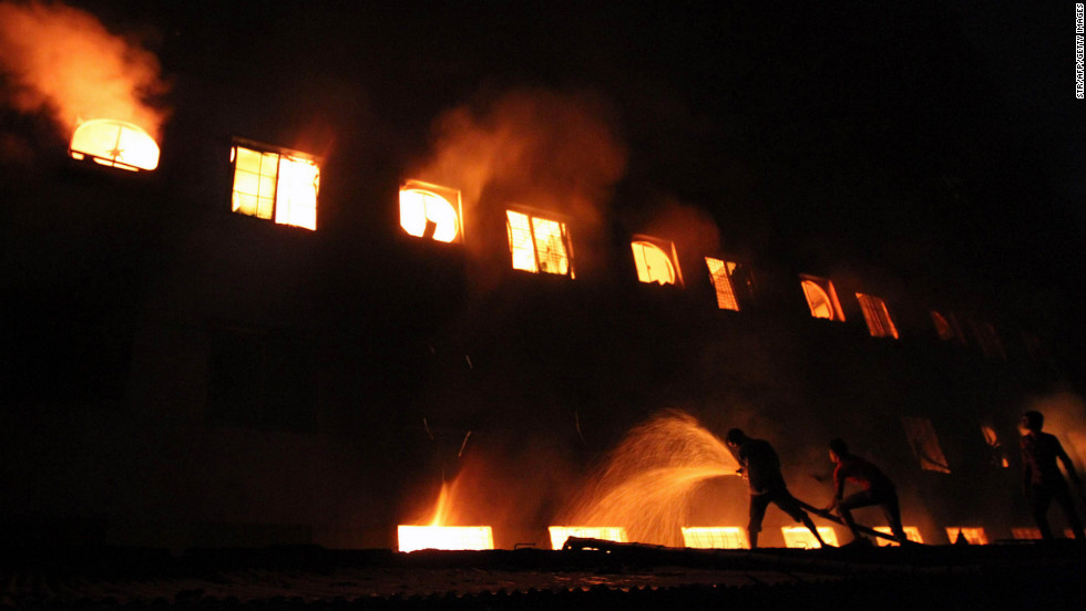 Firefighters try to control a fire at Tazreen Fashions Limited in Savar, on the outskirts of Dhaka, Bangladesh, on November 24. At least 112 people were killed and more than 200 injured in the fire.