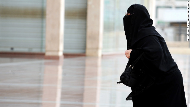 A fully veiled Saudi woman walks into a mall in Riyadh. Women's