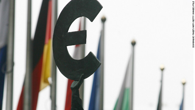 A file image of a statue brandishing a Euro symbol outside the EU parliament in Brussels.