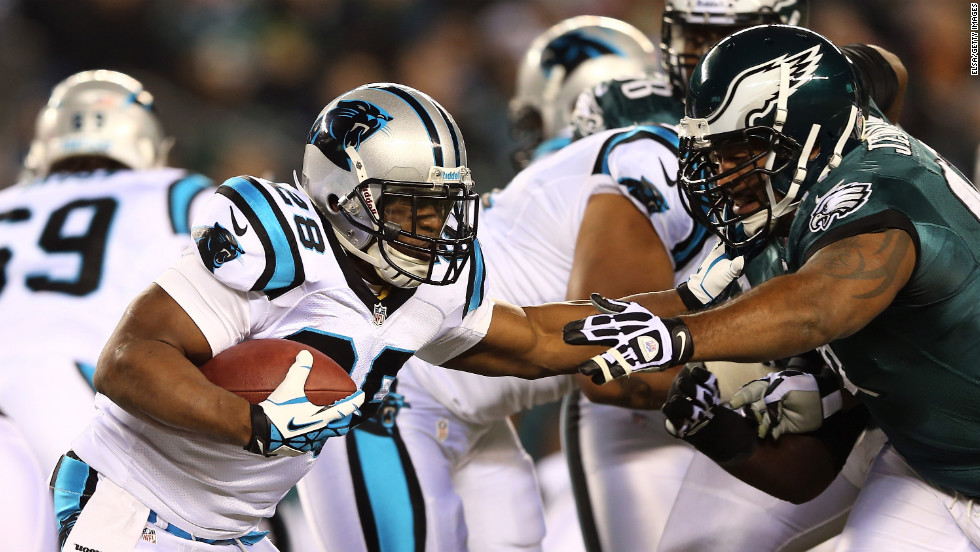 Jonathan Stewart of the Carolina Panthers carries the ball as Cullen Jenkins of the Philadelphia Eagles defends on Monday, November 26, at Lincoln Financial Field in Philadelphia. Check out the action from Week 12 of the NFL and <a href='http://www.cnn.com/2012/11/16/worldsport/gallery/nfl-week-11/index.html'>look back at the best photos from Week 11</a>.