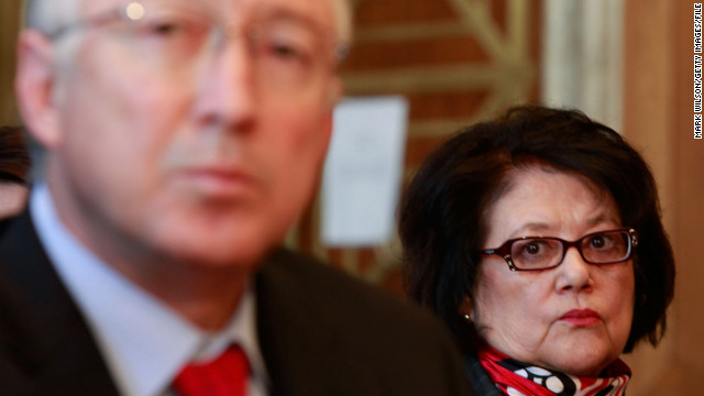 The late Elouise Cobell, right, watches as Interior Secretary Ken Salazar testifies during a Senate Indian Affairs Committee hearing in 2009.