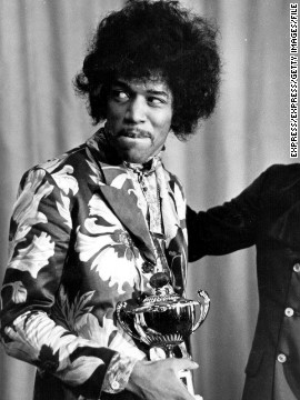 Seen here in October 1967, Hendrix receives an award from Radio One DJ Jimmy Savile. The Experience's first single, &quot;Hey Joe,&quot; was released that year and was a phenomenal hit in the U.K. Another smash, &quot;Purple Haze,&quot; and the group's double-platinum first album &quot;Are You Experienced?&quot; soon followed.