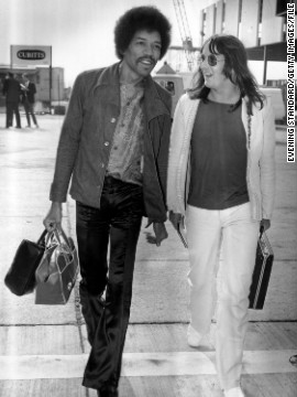 "Here, Hendrix walks through the London Airport with Eric Barrett on September 2, 1970, 16 days before he died at the age of 27. His talent and contributions to both music and style have lived on, however, and musician Andre 3000 is lined up to portray Hendrix in a 2013 biopic, <a href='http://www.imdb.com/title/tt2402085/' target='_blank'>""All Is By My Side.""</a>"