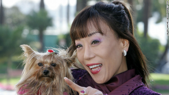 Sumi Jo has three dogs and travels with one of them whenever she can. Here she poses with one during the 41st MIDEM, the world's biggest music trade fair, in Cannes in 2007.