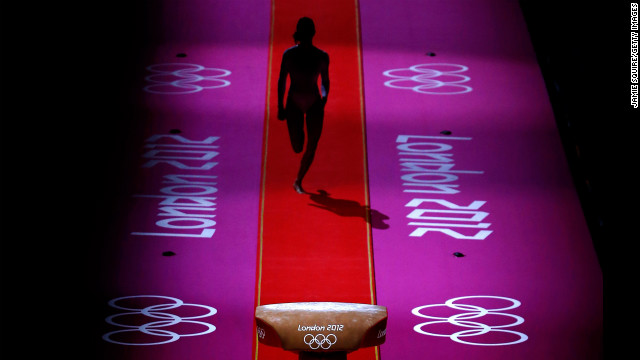 A gymnast performs during warmups before the start of the artistic gymnastics women's team final on Day 4 of the London 2012 Olympic Games on July 31 in London.