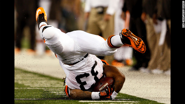 Running back Trent Richardson of the Cleveland Browns hits the ground hard after a play against the Baltimore Ravens on September 27 in Baltimore, Maryland.