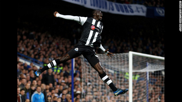 Papiss Cisse of Newcastle United celebrates after scoring the opening goal during the Barclays Premier League match against Chelsea at Stamford Bridge on May 2 in London.