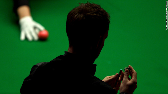 Allister Carter of England competes against Ronnie O'Sullivan of England during the final of the Betfred.com World Snooker Championship on May 6 at the Crucible Theatre in Sheffield, England.