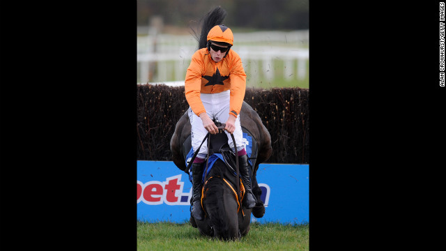 James Reveley falls from Wayward Frolic during the Gain Horse Feeds Novices' Steeple Chase on November 6 in Exeter, England.