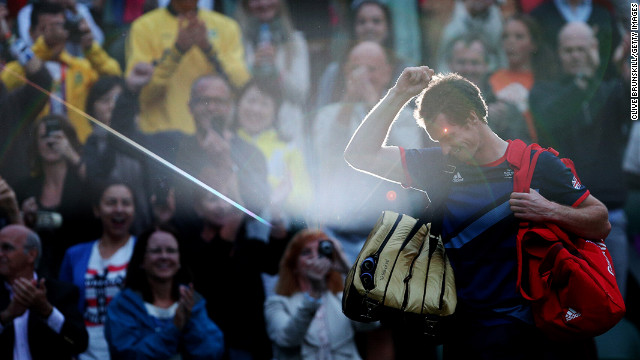 Andy Murray of Great Britain celebrates his 7-5, 7-5 win against Novak Djokovic of Serbia in the semifinal of men's singles tennis on Day 7 of the London 2012 Olympic Games on August 3 in London.