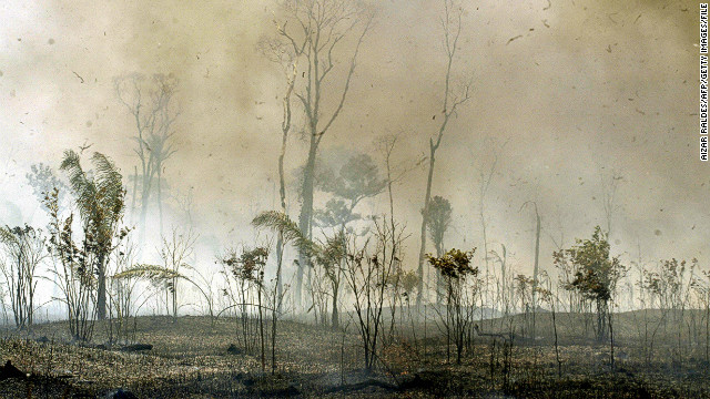 Riberalta, the largest town of Bolivia's Amazon region, is engulfed with fire during September 2005. The Amazon region saw widespread wildfires that turned the rainforest into a carbon source rather than a carbon sink. Another severe drought in 2010 is still being analyzed but researchers believe it could have been even worse.