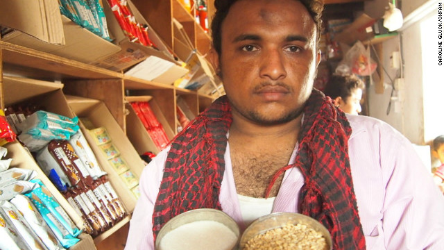 Yemeni shopkeeper Ala'a Abdullah Farag Wans: I worry one day that I'll go out of business because my customers can't pay me back.
