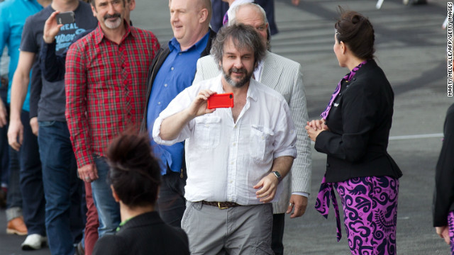 """Hobbit"" director Peter Jackson (c), pictured here at Wellington airport, has filmed a number of blockbusters in his native New Zealand."
