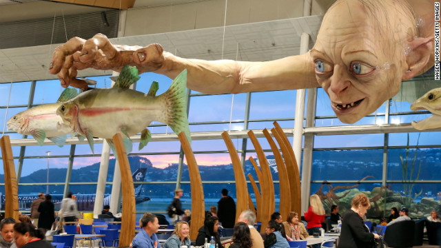 "A giant sculpture of ""Gollum"" dominates Wellington Airport -- city officials expect 100,000 people to take to the streets of the city for Wednesday's premiere."