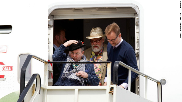 Cast members including Sylvester McCoy (hanging onto his hat) and John Callen arrive in the Middle of Middle Earth, as Wellington has been dubbed.
