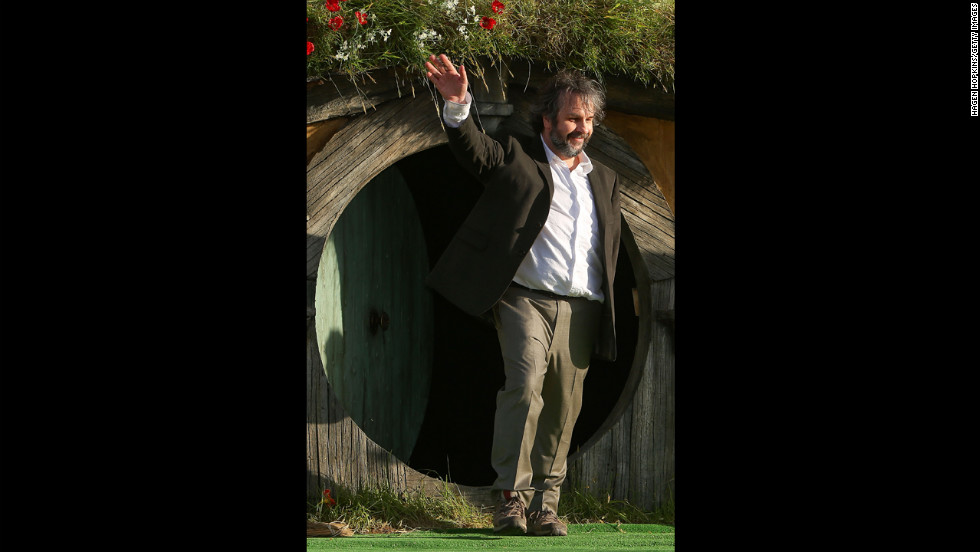 Director Sir Peter Jackson emerges from from a Hobbit house before delivering a speech at the &lt;a href='http://ireport.cnn.com/docs/DOC-887116'&gt;world premiere&lt;/a&gt; of &quot;The Hobbit: An Unexpected Journey&quot; on Wednesday, November 28, 2012, in Wellington, New Zealand.