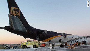 A damaged UPS cargo plane sits on the tarmac in Philadelphia in 2006 after a harrowing onboard fire.