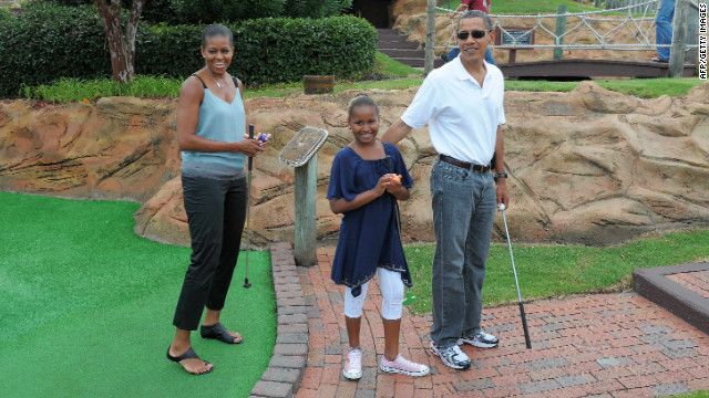 President Barack Obama, his wife Michelle and daughter Sasha tried their hand at mini golf on a holiday in Florida in 2010.