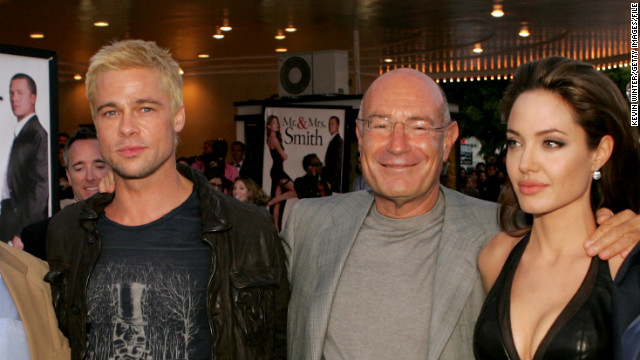 "Fans took sides in the Pitt-Aniston breakup as reports claimed that Pitt's ""Mr. & Mrs. Smith"" co-star Angelina Jolie -- seen here with Pitt and producer Arnon Milchan at a premiere of the film in June 2005 -- was a factor in the split."