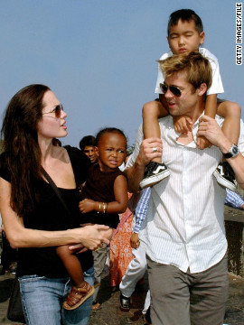 "Brad moved to adopt Zahara and Maddox toward the end of 2005, officially making them Jolie-Pitts. Here, the family walks along the seafront promenade in Mumbai, where Jolie was filming ""A Mighty Heart,"" a project Pitt produced."