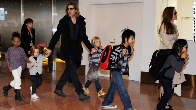 "Every so often, photographers will catch the entire Jolie-Pitt clan all at once, which is what happened here as the family arrives at the Haneda Airport in Tokyo in November 2011. They were in town to promote Pitt's film ""Moneyball,"" which earned him another Oscar nod, his third for acting."