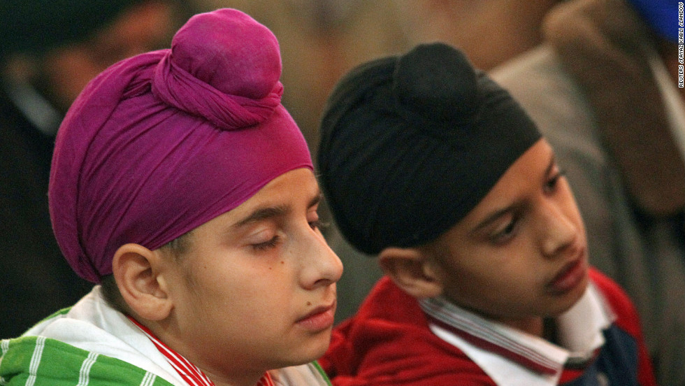 Kashmiri Sikh boys listen to chants inside a Sikh temple in Srinagar, India, on Wednesday, November 28, the 543rd birth anniversary of Guru Nanak Dev, who founded Sikhism and is the first of 10 Sikh gurus. 