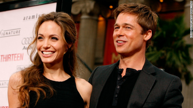 Pitt and Jolie quickly became a fixture on the red carpet and in celebrity gossip magazines as they continued to grow their family. Seen here, the pair arrive at the June 2007 premiere of Pitt's &quot;Ocean's Thirteen.&quot;