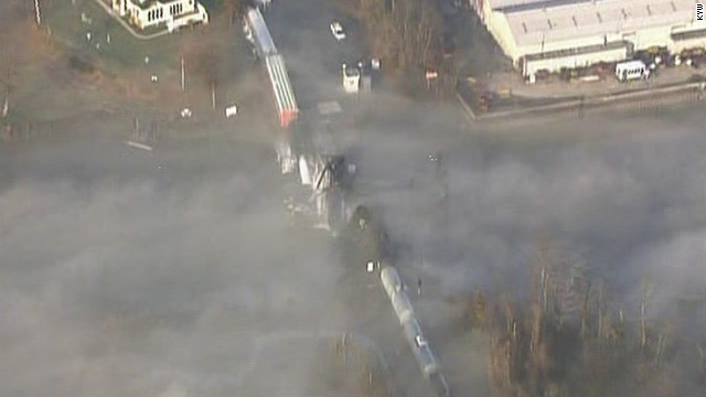 Train with toxic cargo crashes off bridge into creek