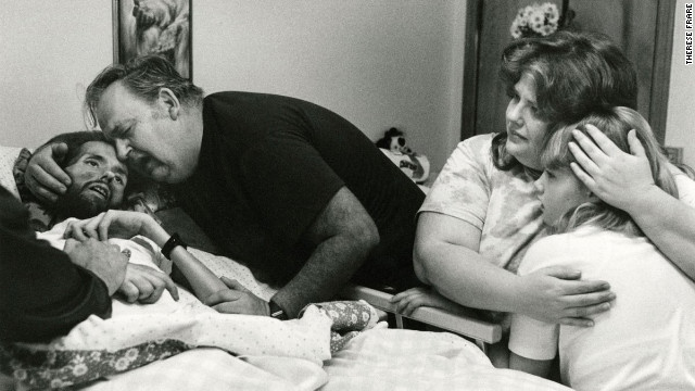 The above image was published in LIFE Magazine in November 1990 showing AIDS patient David Kirby taking his last breaths surrounded by his family in Ohio. The image, shot by Therese Frare, became the face of the HIV/AIDS epidemic. See the entire collection of images on <a href='http://life.time.com/history/behind-the-picture-the-photo-that-changed-the-face-of-aids/?iid=lb-gal-viewagn#1' target='_blank'>Life.com</a>.