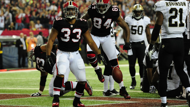 Michael Turner of the Atlanta Falcons scores a first quarter touchdown against the New Orleans Saints on Thursday.