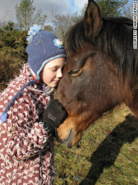 A youngster at Sirona Therapeutic Horsemanship in Devon shares a special moment with one of the clinic's five horses. Equine therapy may help people suffering from depression, bipolar disorder, phobias, anger issues and trauma.