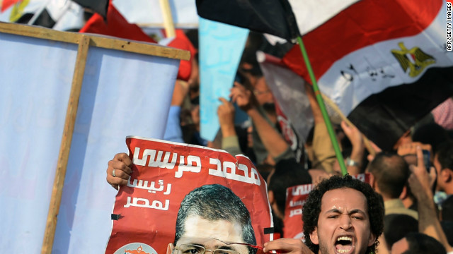 Amid continued unrest, Egypt's president sets vote for constitution referendum