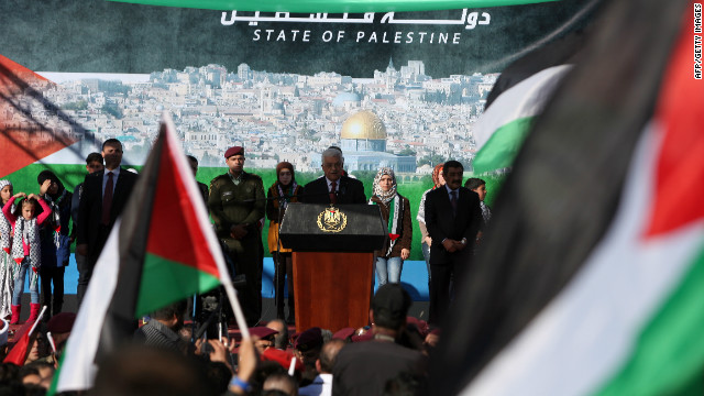 Palestinian Authority President Mahmoud Abbas speaks upon his arrival in the West Bank city of Ramallah on December 2.