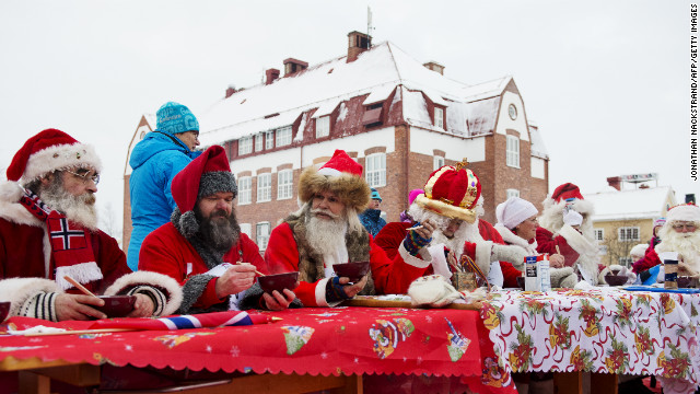 Santas from various countries compete in the porridge-eating contest during the Santa Claus Winter Games in Gallivare on November 17. 