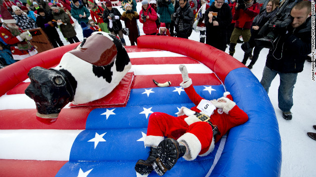 "Japanese Santa Claus ""Santa Paradise Yamamoto"" hits the ground in the reindeer ride event during the competition in Gallivare on November 17. <a href='http://cnnphotos.blogs.cnn.com/2012/12/22/magnum-santas/'>Related photos: Magnum Santas</a>"