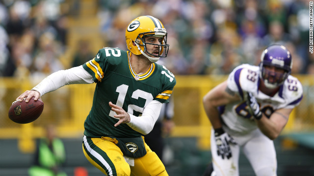 Aaron Rodgers of the Green Bay Packers looks to pass the ball while under pressure from Jared Allen of the Minnesota Vikings on Sunday.