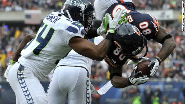 Earl Bennett of the Chicago Bears catches a touchdown pass as he's tackled by Bobby Wagner of the Seattle Seahawks on Sunday at Soldier Field in Chicago.
