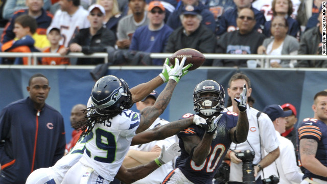 Earl Thomas, left, of the Seattle Seahawks knocks the ball away from Earl Bennett of the Chicago Bears on Sunday.