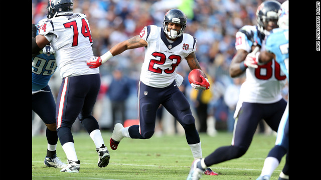 Arian Foster of the Houston Texans runs with the ball on Sunday.