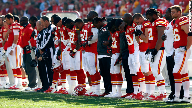 Before their game against the Carolina Pathers on Sunday, the Kansas City Chiefs pause for a moment of silence.