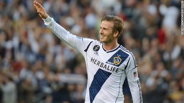 Beckham waves to fans as he walks off the pitch after the game.